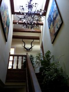Garden staircase,skylight, crystal and steel chandelier,two large nature inspired paintings