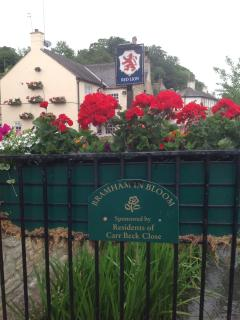 Bramham in bloom - The Red Lion Pub next to Mill Cottage, great pub food with a warm welcome