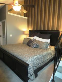 The lower level master has a king size bed and a 48 inch smart television.