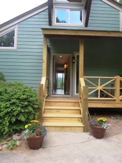The stairs leading up to the entry and covered front porch.