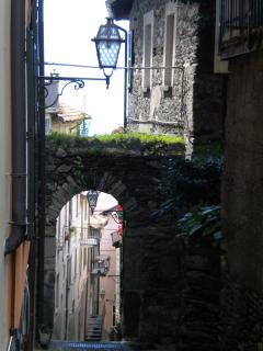 The late medieval arch, the Lake and the staircase leading down to the pier, seen from the Windows