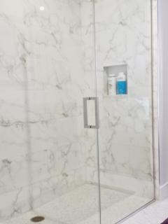 Master Bath Large Walkin Stall in Marble and Mosaic tile floors