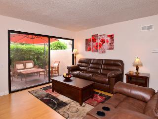 Living room sleeper sofa, private patio behind