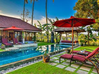 3 bedroom villa, pool furniture, gazebo and living room on left