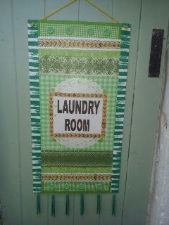 Laundry room with washing machine, tumble drier, iron and ironing board. Washing powder supplied