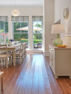 A Dining room full of light and space, overlooking the front gardens
