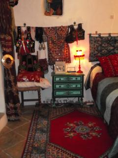 Double bedroom with many Moroccan fixtures, fittings and soft furnishings. All bedrooms have heating.
