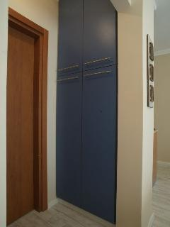 the large wall closet for storage all your clothes