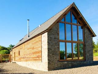 TY CAMLAD, feature beams and floor to ceiling windows, woodburning stove, king-s