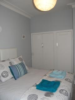 The bedroom has a spacious double wardrobe, 6 drawer chest of drawers and two bed-side tables