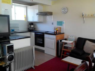 Kitchen with plenty of storage & work top space. Halogen oven, conventional oven, and ceramic hob