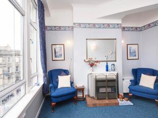This cosy room also has a widescreen TV and comfy chairs to relax & enjoy the magnificent views.