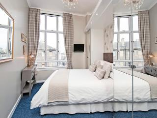 The newly renovated lovely master bedroom has a very comfortable king size bed and quality bedding