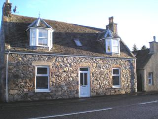 Grant House from the main street of traditional highland village of Tomintoul.