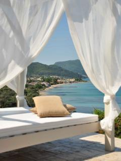 Sun bed overlooking the sea and Messonghi Beach