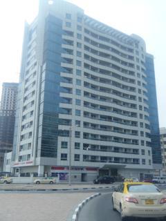 building with rak bank underneath