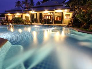 The villa and pool at night