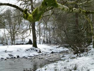 Winter view by stepping stones in Grasmere
