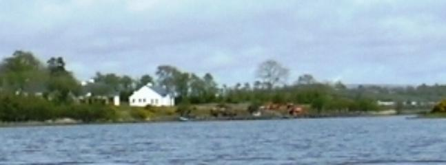 Panoramic view of Portinode Cottages viewed from the lake