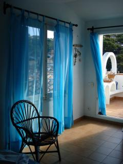 Access to the terrace from bedroom and views to the pine forest