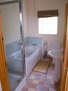 Bathroom with bath and seperate shower