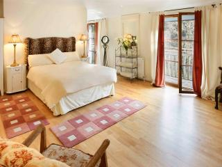 Bedroom with en-suite, with balcony overlooking the river and woods beyond