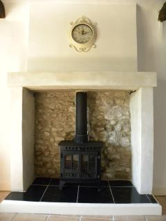 Authentic fireplace with real log burning fire