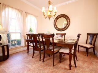 Formal dining - table seats 8 with plenty of room for highchair or additional adults