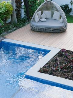 Ample sunloungers by private pool