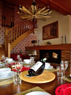 Dining area with open fire, staircase and vaulted ceiling