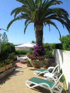 There are ample sunloungers chairs etc. throughout the property