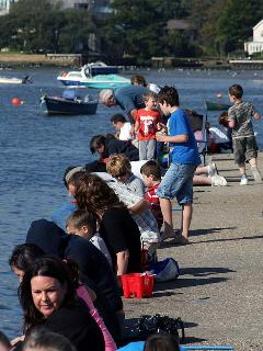 Kids love to go crabbing on the harbour wall at Mudeford