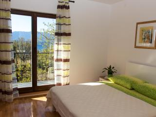 Double bedroom with terrace overlooking garden and sea views