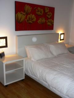 Bedroom featuring a Queen size bed with quality linens and towels provided.