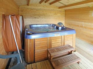 Soak in the bubbling spa, open the cabin doors and soak up the view!