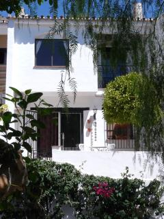 A quaint Spanish house with all the comforts of home in a quiet, friendly community.