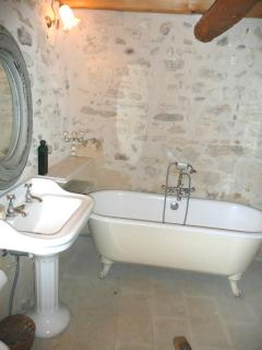 and close to the 'stone bathroom' with grand french sink, claw feet bath &