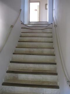 The stairs leading to the bedrooms