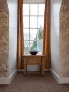 The garden bedroom on the first floor has views over the garden