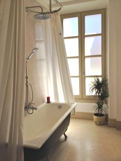 Take a relaxing soak in the deep bath after your day out.
