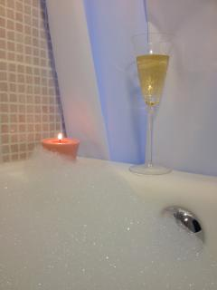 Soak & relax with a glass of something bubbly.
