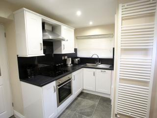 Modern, fully equipped kitchen includes washer/dryer & dishwasher