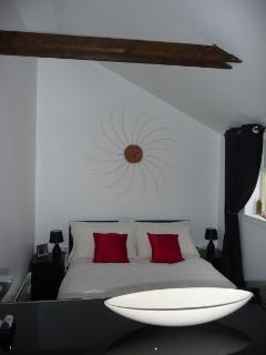 The cosy bedroom area, complete with alarm clock (should you need one) and MP3 attachment so you can