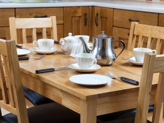 Solid oak table and chairs in kitchen