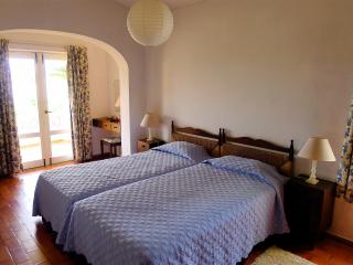 Master bedroom, French windows open onto terrace, lots of cupboards etc