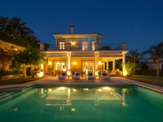 Pool and villa at night.
