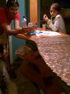 Glueing down pennies. 2/3 of the way done.