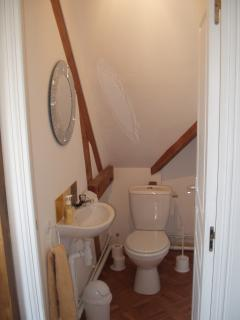 Seperate WC with hand basin, towel, soap, toilet paper and cleaning products