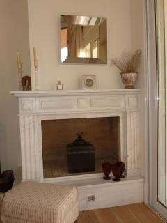 The marble fireplace in the living room