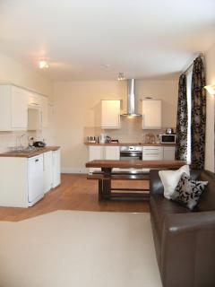 Fully equipped kitchen, & dining for up to ten to twelve guests in the largest Apartment Bell One